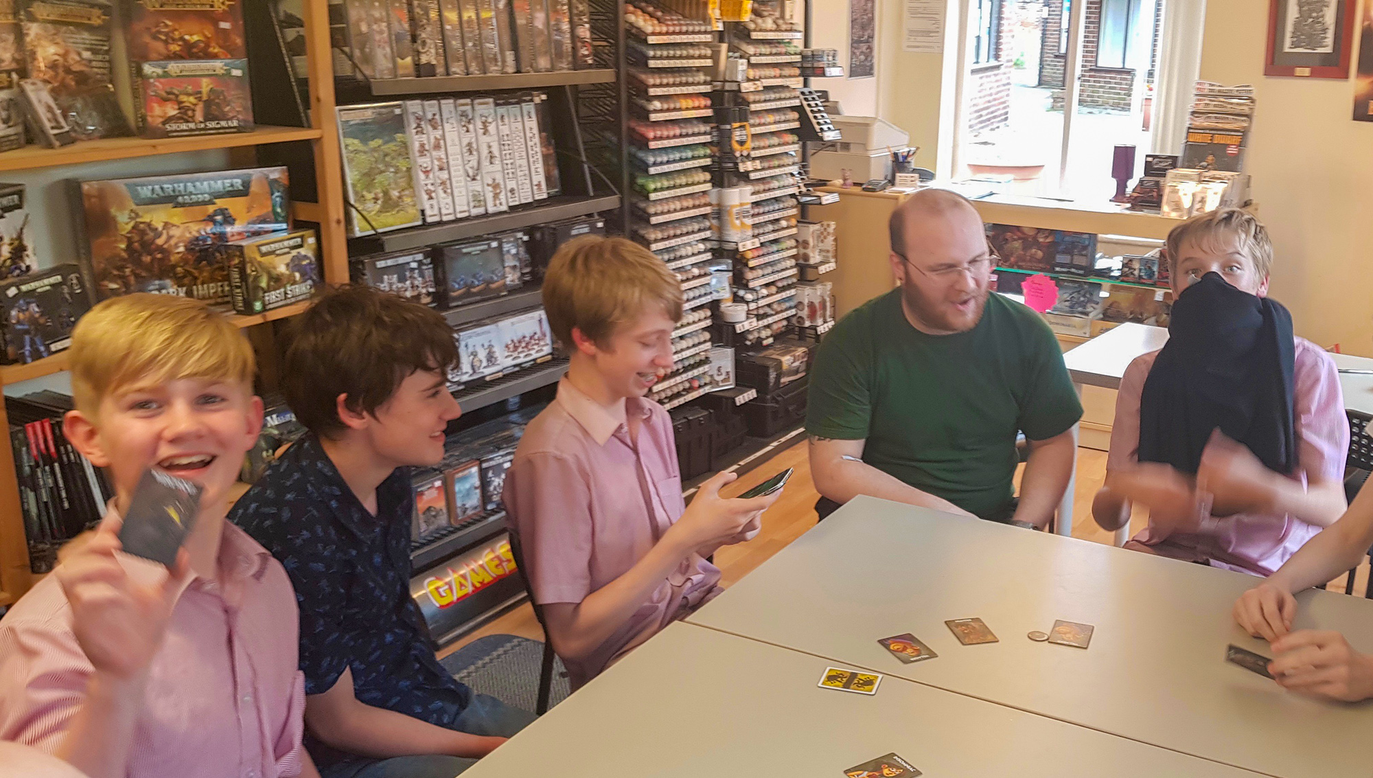 a group playing card game at NOCS